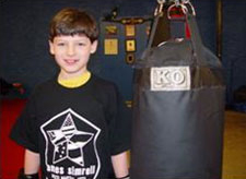 Joseph and his new KO Fighgear Youth Heavy Bag - Front View