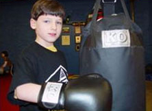 Joseph and his new KO Fighgear Youth Heavy Bag - Side View