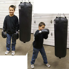 Cole With his KO Fightgear Youth Heavy Bag.